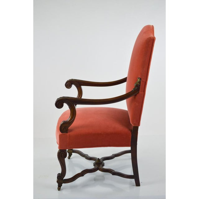 Beautiful open armchair, dating from 1890-1910. It features an elegantly carved frame, with a tall back. There is a little...