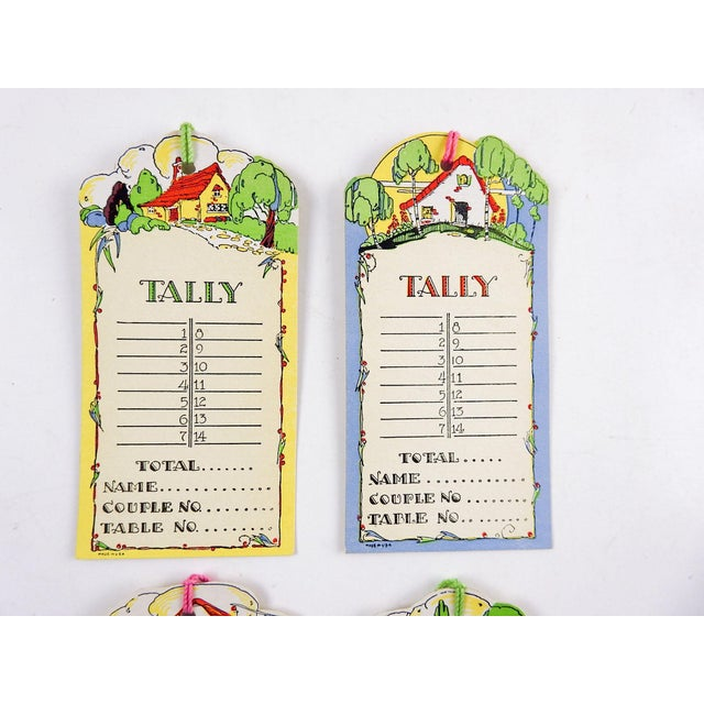 Set of 4 circa 1930's die cut bridge tally cards. Fairy tale cottage with flowers, unused, with original cord, age toning,...