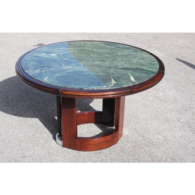 Unique French Art Deco Macassar ebony round center table With Green Marble Top. circa 1940s , beautiful Oval center base...