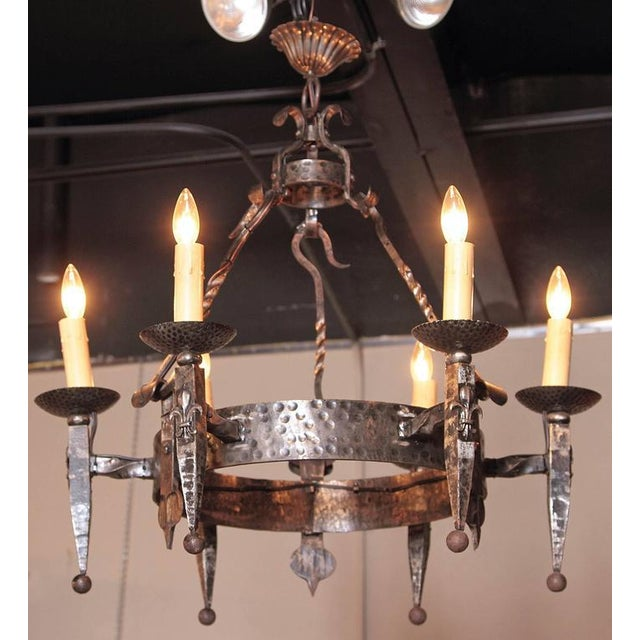 This elegant Gothic chandelier was crafted in France, circa 1900. Round in shape and forged from wrought iron, the...