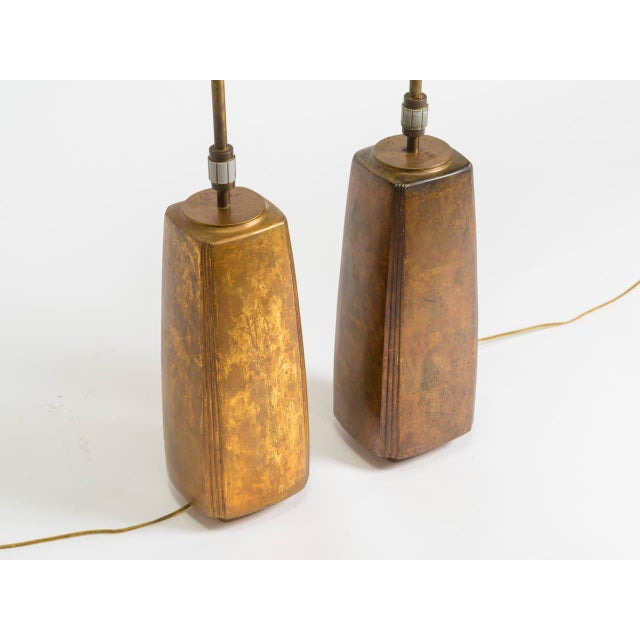 Pair of bronze table lamps by Stewart Ross James for Hansen. Measure: Total height is 33 inches.
