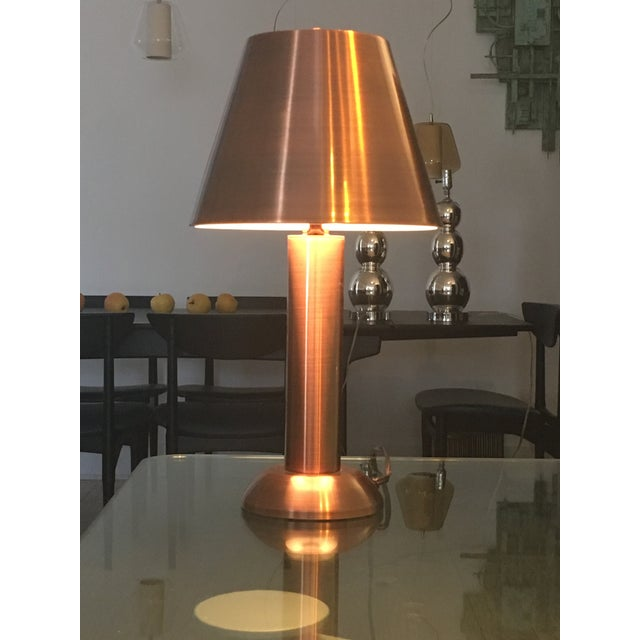Copper table lamps with matching copper shade. Gives a soft ambient light, ideal for a bed side table or desk.