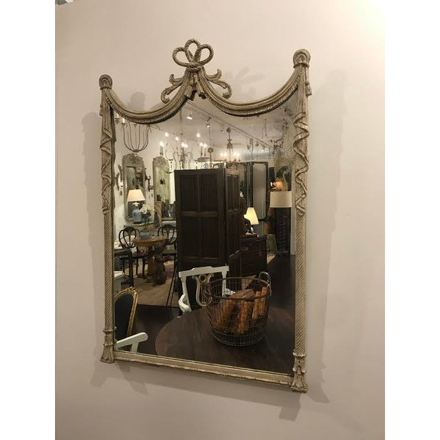 This is a gorgeous antique French mirror from the 19th century. It's made of wood painted in a light gray and carved in...