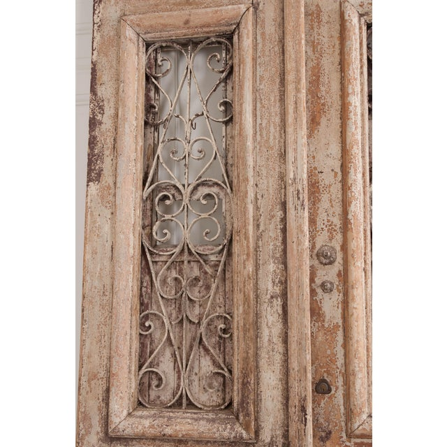 Tall Pair of French Napoleon III-Style Early-20th Century Painted Pine and Wrought-Iron Exterior Entrance Doors For Sale - Image 4 of 11