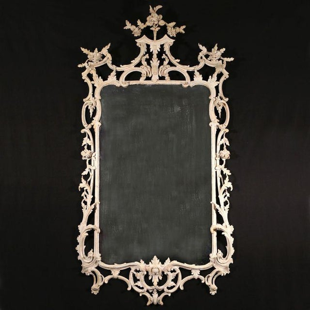 """An important mid 18th-century carved rococo frame, forcefully carved with flowers, leafage, elongated """"C"""" scrolls..."""