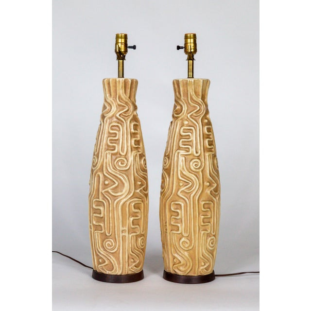 Mid-Century Modern Tall Mid-Century High Relief Carved Tan Pottery Lamps - a Pair For Sale - Image 3 of 11
