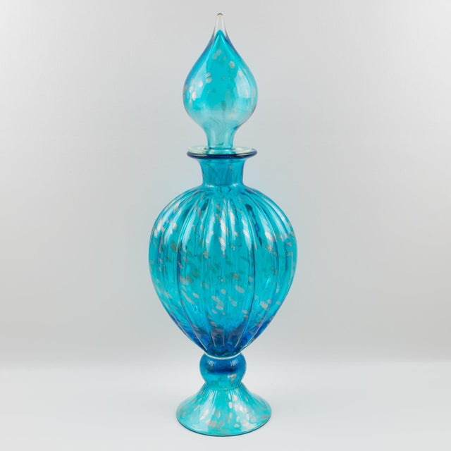 Nice oversized turquoise blue glass apothecary dispenser or jar, made in Italy in the region of Empoli. A stately and eye-...