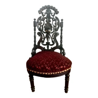 Victorian Heavily Carved Black Forest Style Chair For Sale