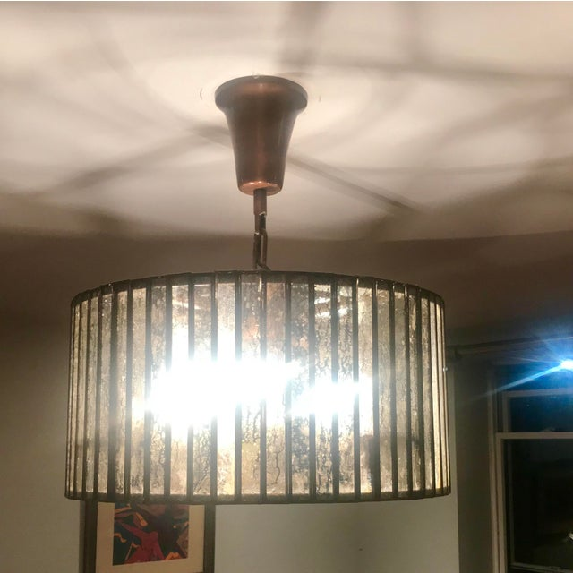 Reflecting the style of Italian drum lights from the 1950s, our contemporary interpretation features narrow slices of...