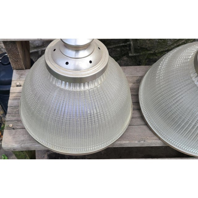 """This is a great pair of Ann Morris 12"""" Rim & Diffuser hanging pendant lamps, c1999. Each hanging lamp with a polished..."""