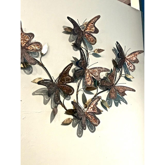 This is a well elaborated brass and mixed metal Jere-style Wall sculpture that dates to the mid-20th century. The...