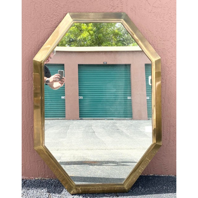 Stunning vintage Mastercraft console mirror. Done in a brass finish with lots of sharp angles. Truly an impressive mirror....