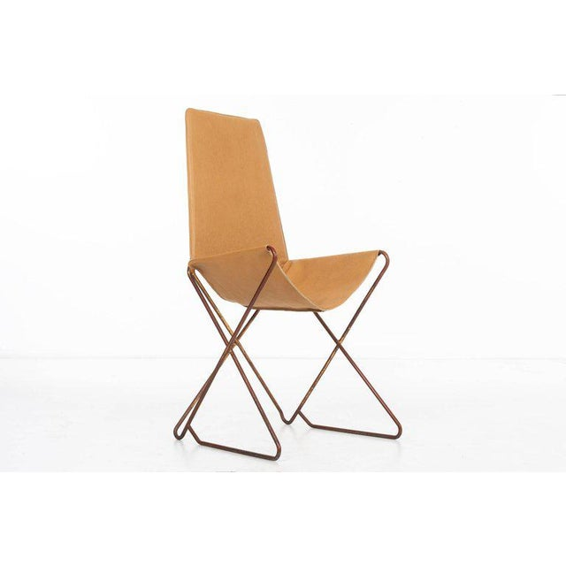 ARTURO PANI (1915 - 1981) 'Prototype' leather upholstered sling-style throne chair raised on a gilt bent metal frame....