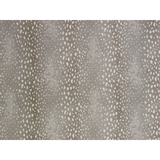 A perennial favorite among interior designers, the Stark Studio Rugs Deerfield design blends a classic animal hide motif...
