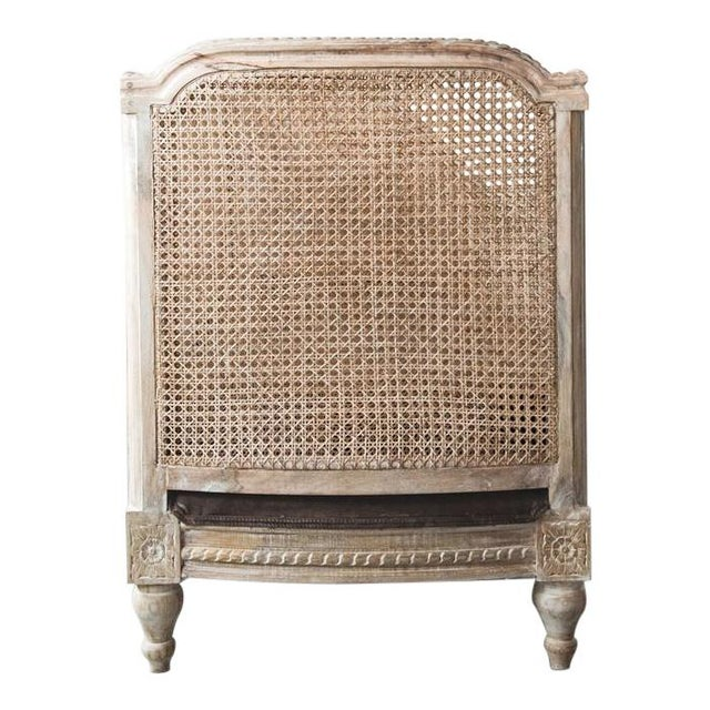Classic Louis XVI style French caned day bed made from solid wood with a hand upholstered brown velcet cushion....