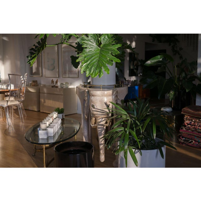 style: rolling, island, bar table material: wood composite, brass, smoked glass brand: Marge Carson age: vintage...