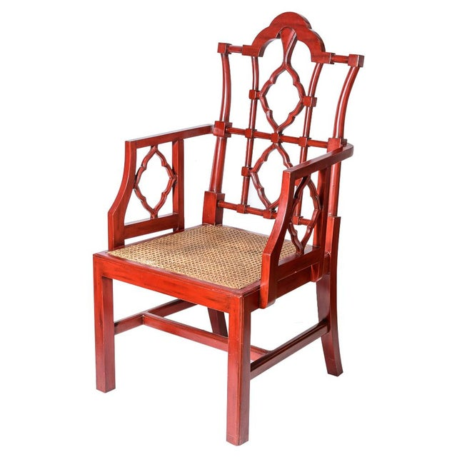 Fabulous Pair of Chinese Red Lacquered Chippendale Style Gothic Chairs with Cane Seats. Very good original condition, some...