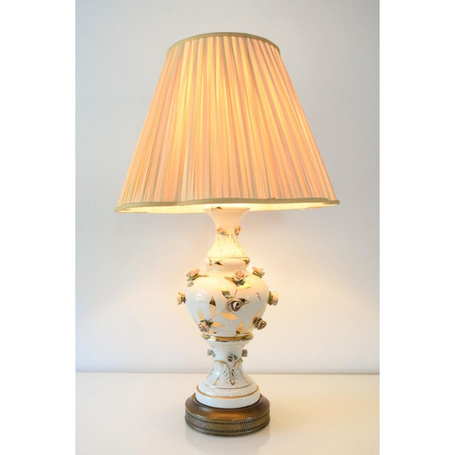 • Gorgeous antique Victorian floral table lamp. • Elegant porcelain ceramic body with stunning hand painted raised and...