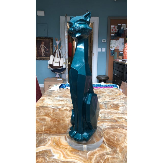Unique pair of lacquered geometric cats on lucite bases.