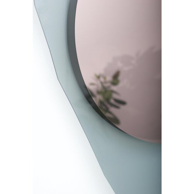 Glass repeated mirror I by Oskar Peet and Sophie Mensen Dimensions: 108 x 151 x 6.5 cm Materials: grey, green and rosé...