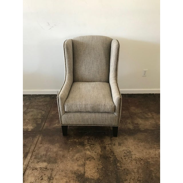 Vintage Wing Back chair recently upholstered in Mark Alexander textured raw linen fabric in grey and natural. Down feather...