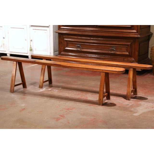 Dressed a farm table with this elegant pair of antique trestle benches. Crafted in the Poitou region of France, circa...