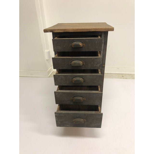 VINTAGE WOOD FILE CABINET. Five drawer vertical chest. Original wood tones with nice brass pulls. Drawers all slide well....