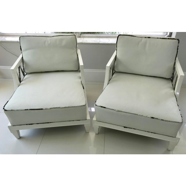 Exquisite pair of Grosfeld House armchairs, circa 1940's. They have been completely reconditioned in and white lacquer...