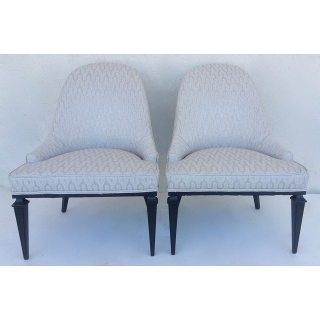 Rare pair of Michael Taylor for Baker Furniture Company accent/ lounge chairs circa 1950s, with sloped arms, curved seat...