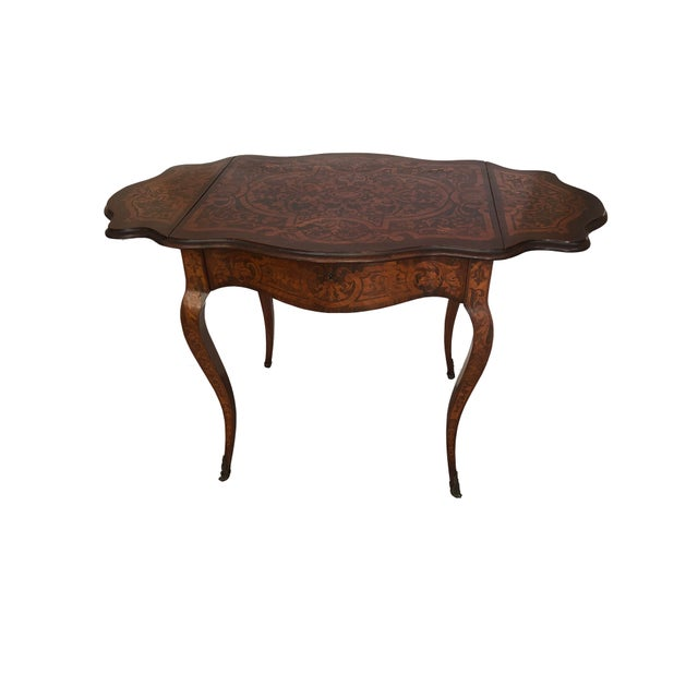 """A French Rosewood and Satinwood marquetry inlay drop leaf table with a single drawer. Circa 1900. Without leaves up is 27""""..."""