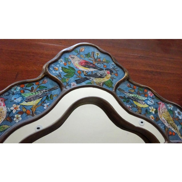 A delightful reverse glass hand-painted song bird mirror...in a pretty shape. These birdies seem to be outline painted...