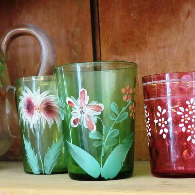 Offering a lovely antique Victorian glass tumbler.. This one is a soft shade of green, hand decorated with a charming...