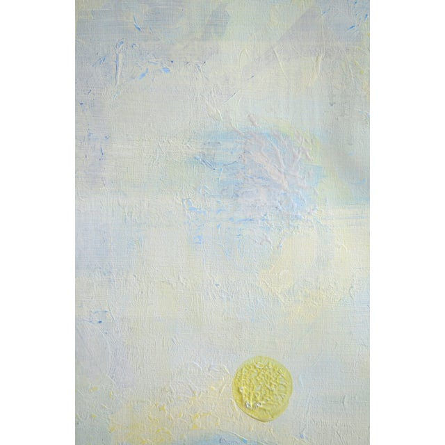 "Abstract cream, blue, and yellow orb painting. The seller says: ""This piece is an experiment in materials where I play..."