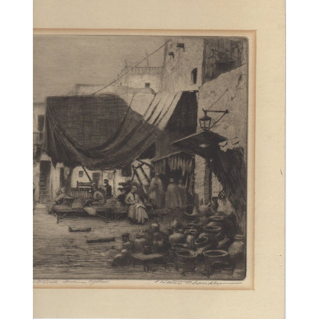 Lovely original etching by listed artist Walter Chandler. This pencil signed etching shows an Arab Market scene....