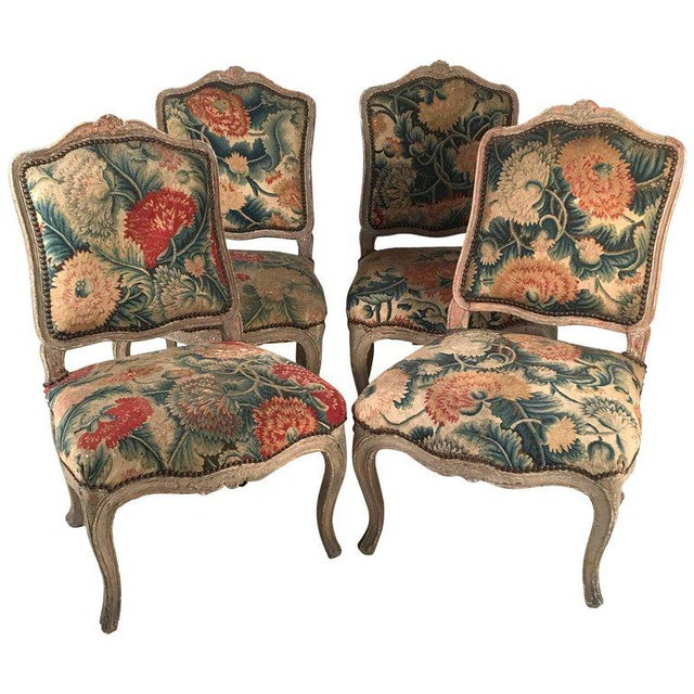 superb set of four french louis xv chairs with period floral