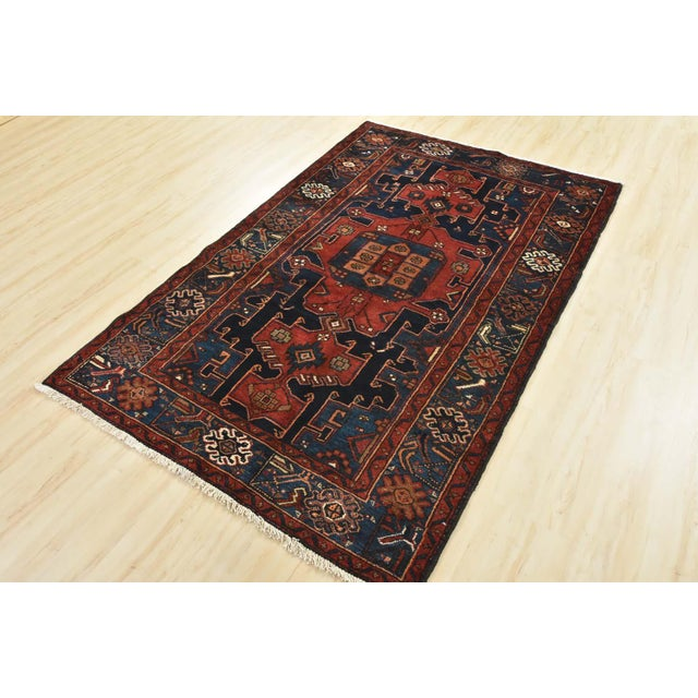 This is an authentic vintage Persian Hamadan rug hand-knotted in Persia with an all wool pile on a cotton foundation and...