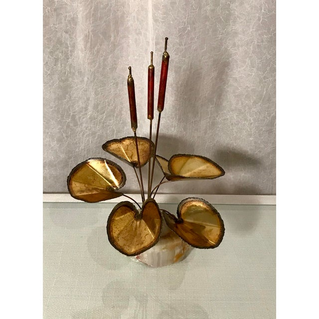Vintage, mid-century, brutalist, torch cut brass cattail sculpture. Attributed to Curtis Jere. This piece is unsigned. The...