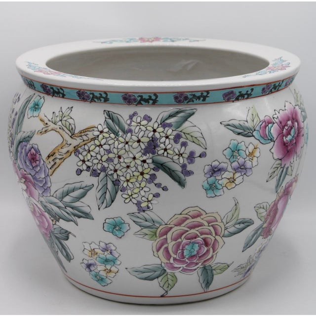 A high quality Chinese/Oriental planter, decorated with lotus flowers, cherry blossoms, & peonies. Hand painted, with koi...