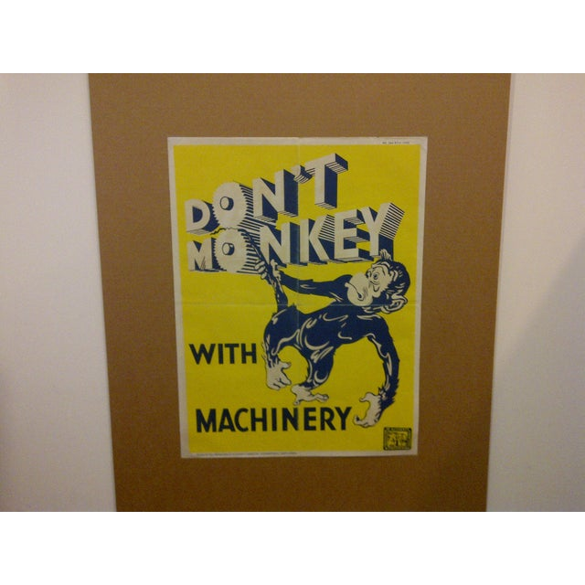 """Vintage South African safety poster. Circa 1949. The poster reads -- """"don't monkey with machinery"""". The poster was issued..."""