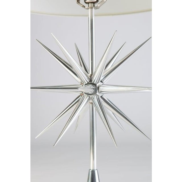 Pair of aluminium starburst lamps on cone bases. Nickel-plated solid brass hardware. Custom-made for Avalon. May be...
