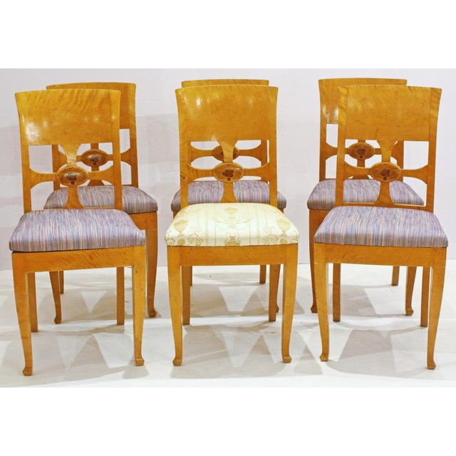 by cabinetmaker Anton Kjaer, Copenhagen, Denmark, a set of six (6) birch chairs with panel backs and open cross with...