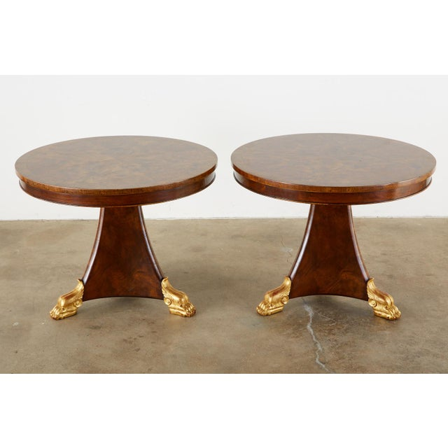 Fine matched pair of English Regency style pedestal tables. Featuring a dramatic burl veneer top. The round tables could...