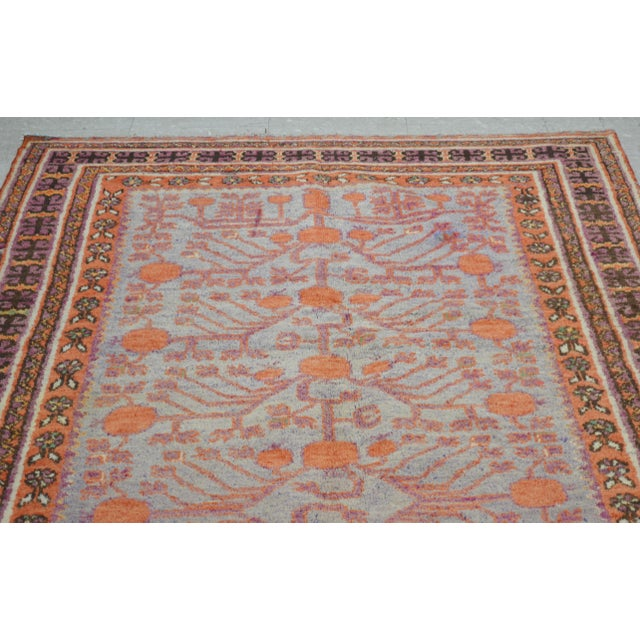 Antique Khotan hand made rug with natural colors, unique pomegranate and tree of life pattern.