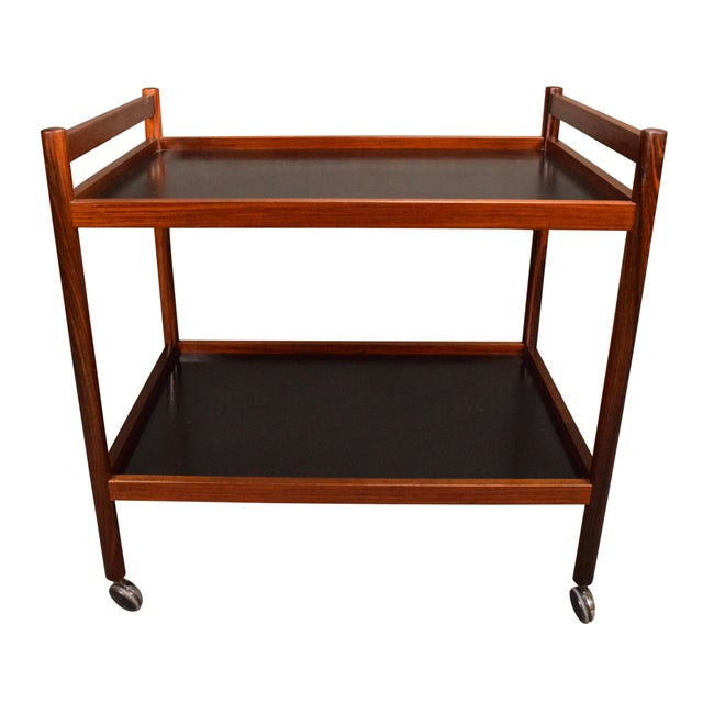 Here is a beautiful 1960's danish modern cocktail cart in rosewood and black laminate recently imported from Denmark to...