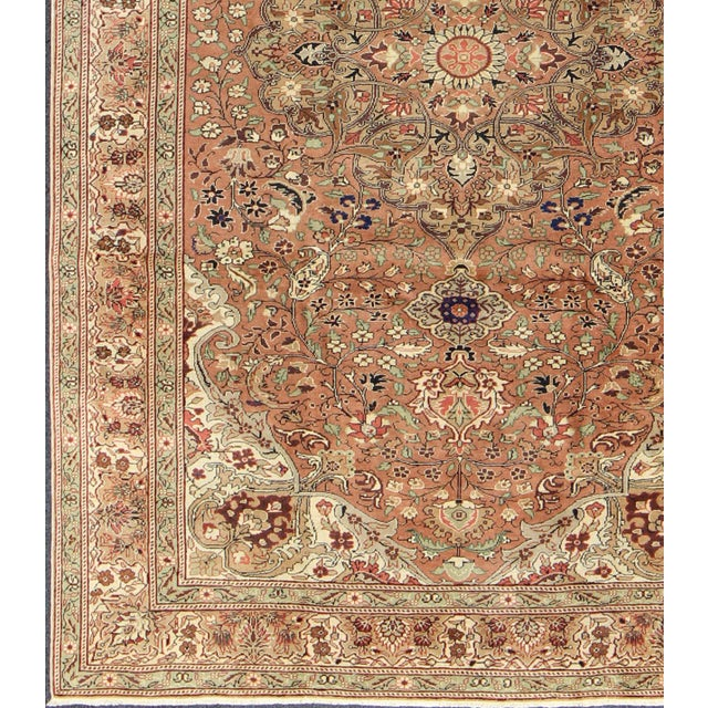 This beautiful mid-20th century vintage Turkish Kaysari rug, woven with supple wool, displays a glorious central medallion...