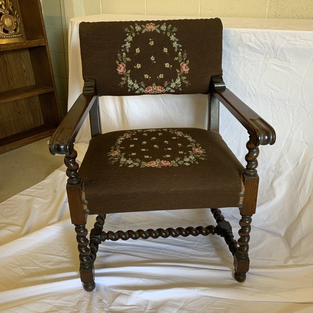Fab Jacobean style barley twist chair of mahogany and needlepoint wool upholstery. Large brass nail head trim. Fabric is...