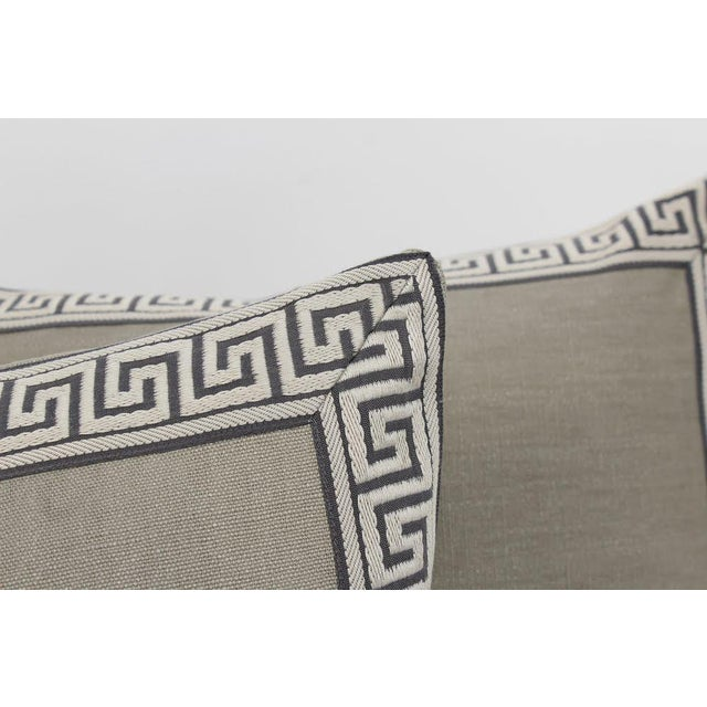Pair of custom slate color linen pillows with coordinating charcoal-and-ivory colored Greek key tape on fronts. Solid...