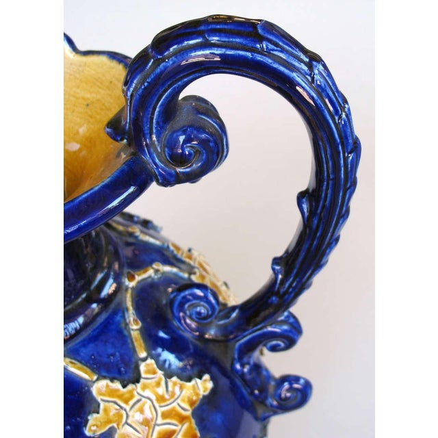 A Pair of Italian Cobalt Glazed Majolica Ewers with Raised Decoration For Sale - Image 4 of 7