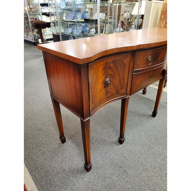 Beautiful antique Georgian style inlaid flamed mahogany sideboard, featuring lion head pulls, two central dovetail drawers...