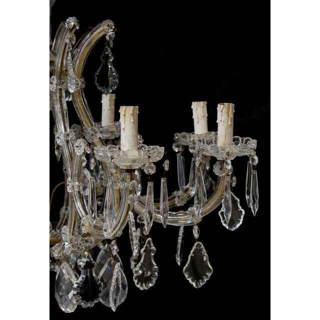 Italian Maria Theresa style nine-armed cut-glass chandelier dating back to 20th century. Eight arms. This Italian vintage...